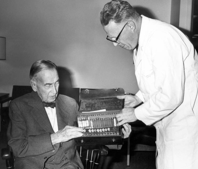 Chauncey B. Borland (left) and Rush Medical College Dean Mark H. Lepper, MD (right), present a 75-year-old medical kit to the college in this 1971 photo.
