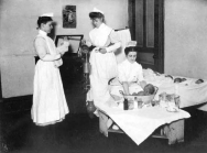 Three nurses at work in the Presbyterian Hospital infant nursery around 1905. One nurse is bathing newborns, while two others prepare an incubator for a premature baby.