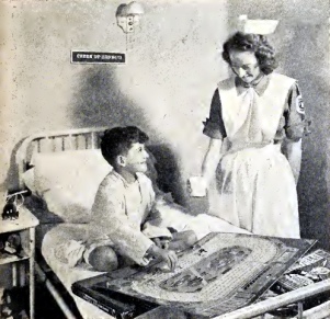 A student nurse assists a young Presbyterian Hospital patient in this 1947 photo.